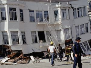 old white apartment building collapsed