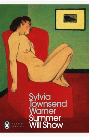 Woman reclining on red couch
